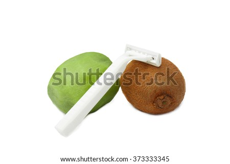 concept of remove unwanted hair. kiwi fruit and razor isolated on white background. one kiwi purified, the second kiwi still has a hairy skin.