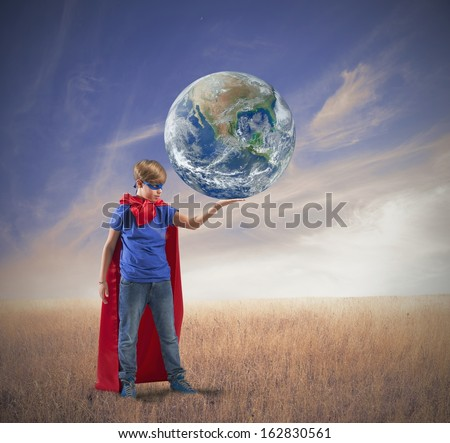 Concept of save the world with young super hero- world provided by Nasa - stock photo
