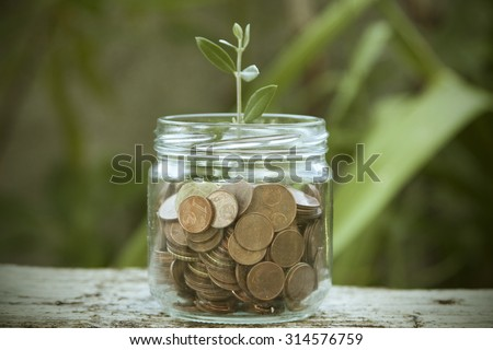 concept of saving, economy and finance - stock photo