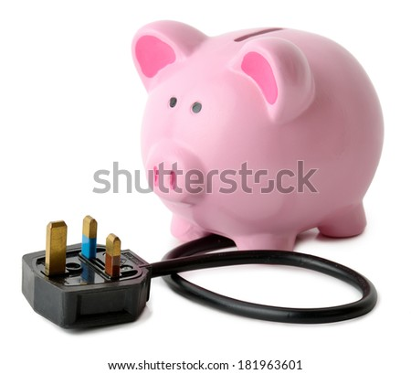 concept of saving energy a piggy bank with a plug isolated on a white background - stock photo