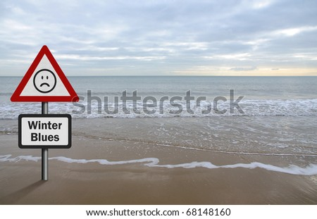 Concept of Seasonal Affective Disorder, with beach / sea background