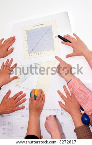 Concept of several hands preparing project workshop - stock photo