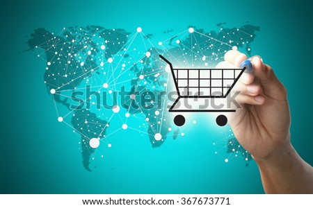 Concept of shopping on-line, e-commerce business, Hand of businessman drawing cart over world map and graphic of network connection. - stock photo