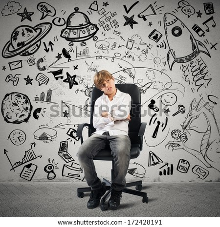 Concept of small genius with kid and varius drawings - stock photo