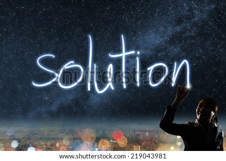 Concept of solution, silhouette asian business woman light drawing. - stock photo