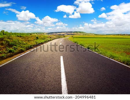 Concept of straight path to success. Asphalt road over blue sky background. - stock photo
