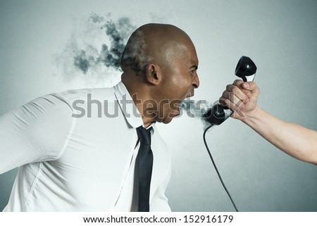 Concept of stress of a businessman on the phone - stock photo