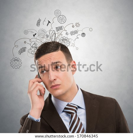 Concept of stress with businessman calling by phone - stock photo