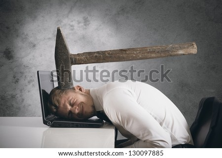 Concept of stress with businessman with an hammer over head - stock photo