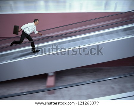Concept of stressed businessman in airport - stock photo