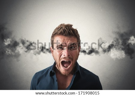 Concept of stressed businessman with smoke coming out of his ears - stock photo