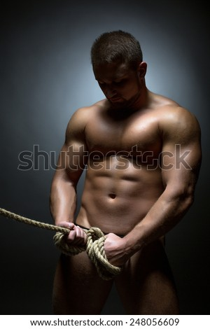 Concept of struggle. Muscled naked man bounded - stock photo