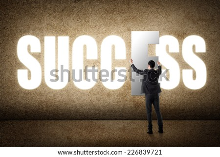 Concept of success, asian business man with text. - stock photo