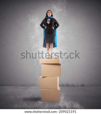 Concept of successful businesswoman like a super hero - stock photo