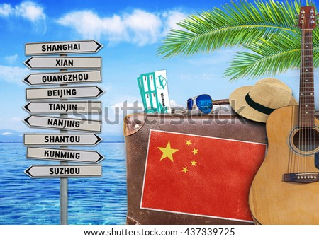 Concept of summer traveling with old suitcase and China town sig - stock photo