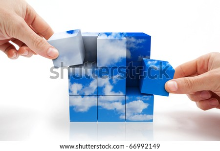concept of sustainable development with Cube puzzle and sky - stock photo