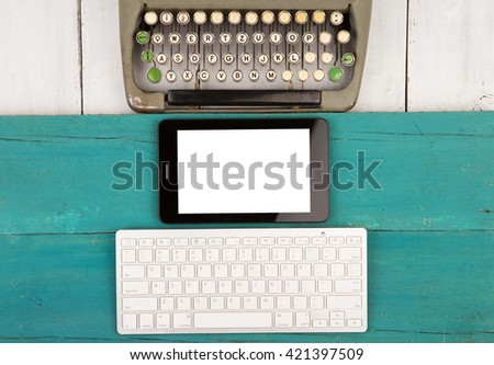 Concept of technology progress - old typewriter and new computer keyboard, tablet pc on wooden background. Copy space - stock photo