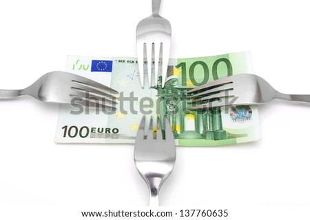 concept of tight budget with banknote and fork - stock photo