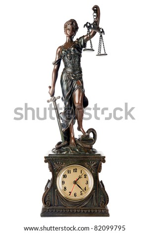 Concept of time for Justice: Themis, mythological Greek goddess, blind and holding empty balance and sword in hands, standing on defeated snake and book, a table clock, isolated on white background - stock photo