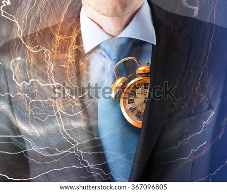 Concept of time with businessman in suit and clock - stock photo