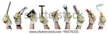 concept of tools in hands with gloves - stock photo