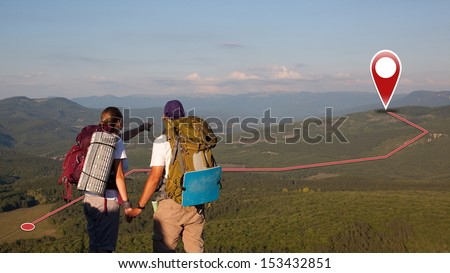 Concept of tourists couple with GPS Icons. Navigation on the mountains. Global Positioning System. Push pin pointing at mountain - stock photo