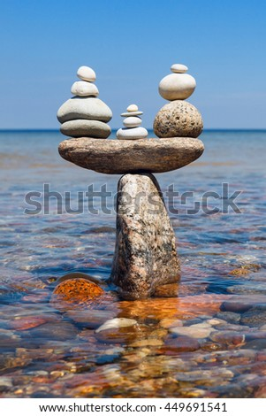 Concept of tranquility and balance. Rock zen in the form of scales - stock photo