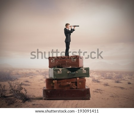 Concept of travel with businessman with binocular - stock photo