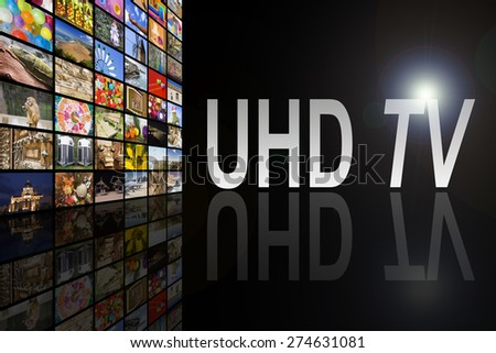 Concept of Ultra High Definition TV on black background with reflection - stock photo