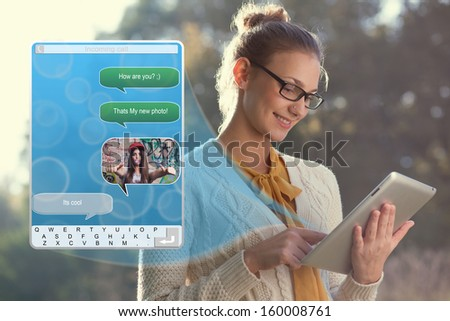 Concept of using wireless technology by woman, video call, typing message on tablet. Incoming call. interface of tablet pc screen - stock photo