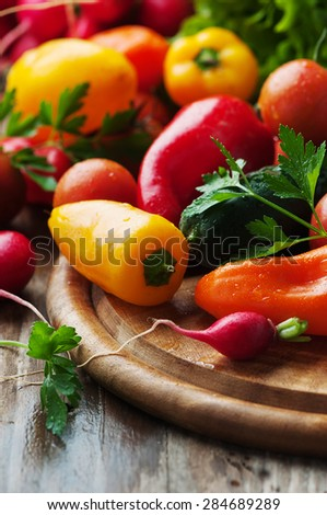 Concept of vegan food with raw vegetables, selective focus - stock photo