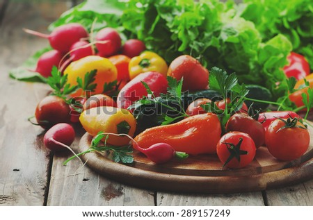Concept of vegan food with raw vegetables, selective focus and toned image - stock photo
