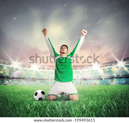 Concept of victory with soccer player cheering - stock photo