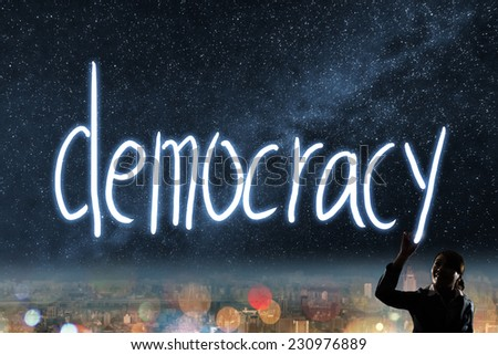 Concept of vote, election, democracy,  silhouette of asian business woman light drawing. - stock photo