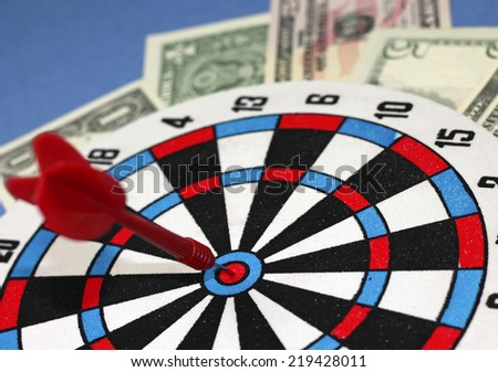 "Concept of wealth - red dart hit at ""bull's eye"", close-up - stock photo"