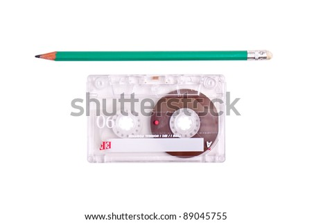 concept of winding a cassette tape with a pencil - stock photo
