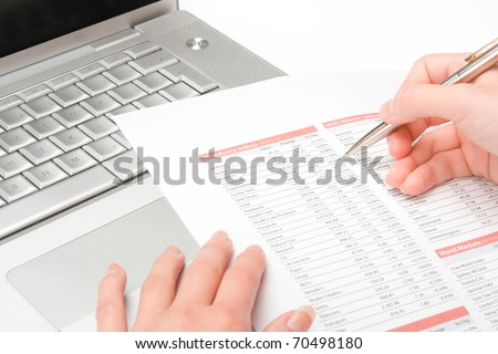 Concept of woman business analysis - data sheet, and laptop - stock photo