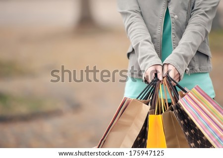 Concept of woman shopping and holding bags, closeup images. - stock photo