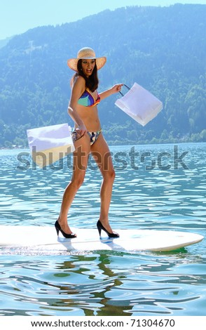 Concept of woman shopping walking on surfboard with shopping bags.