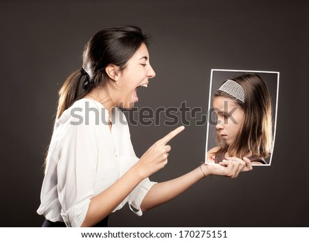 concept of woman telling off a little girl - stock photo