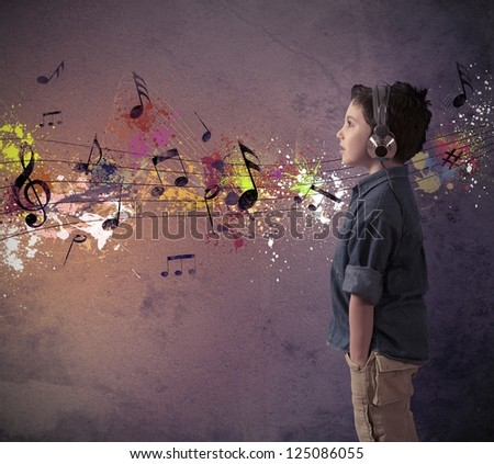 Concept of young boy listening to music - stock photo
