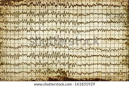 concept old graph brain wave EEG with paper background - stock photo