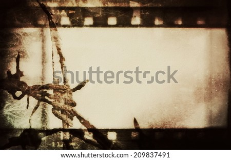 concept old grunge film strip and barbed wire background - stock photo
