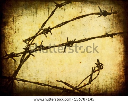 concept old rusty security barbed wire fence - stock photo