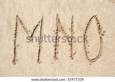 Concept or conceptual abstract set or collection of fonts in sand on exotic beach sea shore handwritten in a sandy texture background in summer for alphabet,education,letter,text,vacation or tourism - stock photo