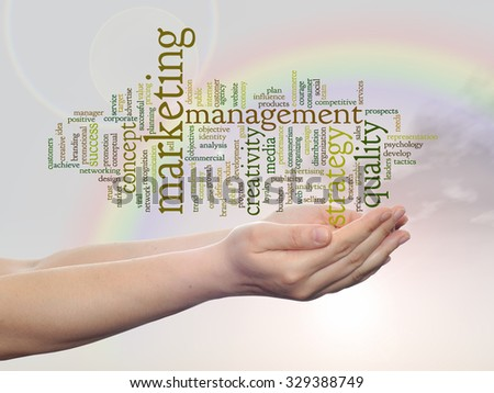 Concept or conceptual abstract word cloud or wordcloud, man or woman hand, rainbow sky background, metaphor to business, trend, media, focus, market, value, product, advertising, customer or corporate - stock photo