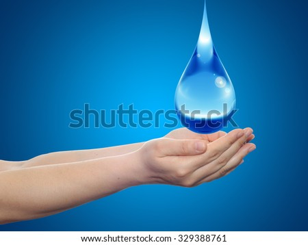Concept or conceptual blue water or liquid drop falling in two woman hands on blue gradient background  for splashing, palm, clear, purity, freshness, nature, clean, health, rain, environment, drinks - stock photo