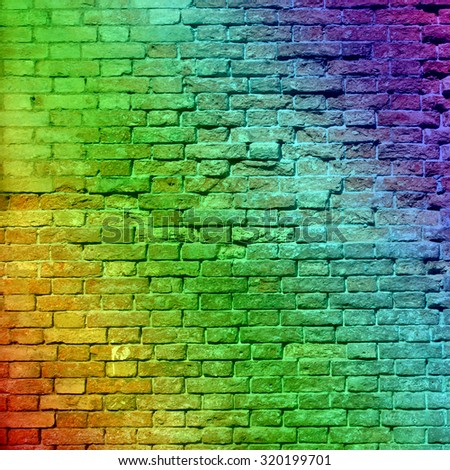 Concept or conceptual colorful painted or graffiti old vintage grungy brick wall texture or urban background, metaphor to art, city, street, artistic, creative, culture, retro, underground brickwall - stock photo