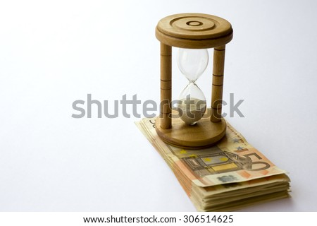 Concept or conceptual euro paper money banknote with a sand glass or time background, metaphor to business, finance, loan, success, wealth, banking, economy, profit or commerce, debt, loss or vision - stock photo