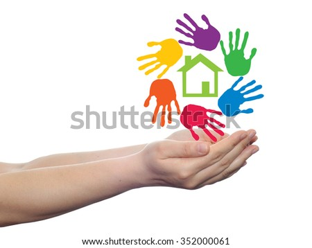 Concept or conceptual green house or building sign or symbol with child or human handprints circle isolated on white background, metaphor to environment, home, eco, ecology, peace, energy home - stock photo